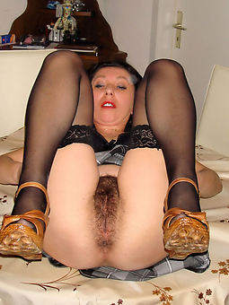 hairy granny in stockings stripping